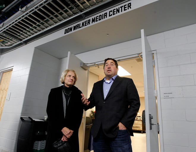 Sue Walker, widow of longtime Journal Sentinel journalist Don Walker, listens as Milwaukee Bucks President Peter Feigin (right) speaks at a ceremony honoring her late husband at the Fiserv Forum on Friday. The Forum named its new media center for Walker, who covered the project in its early stages before his death in 2015. Angela Peterson/Milwaukee Journal Sentinel