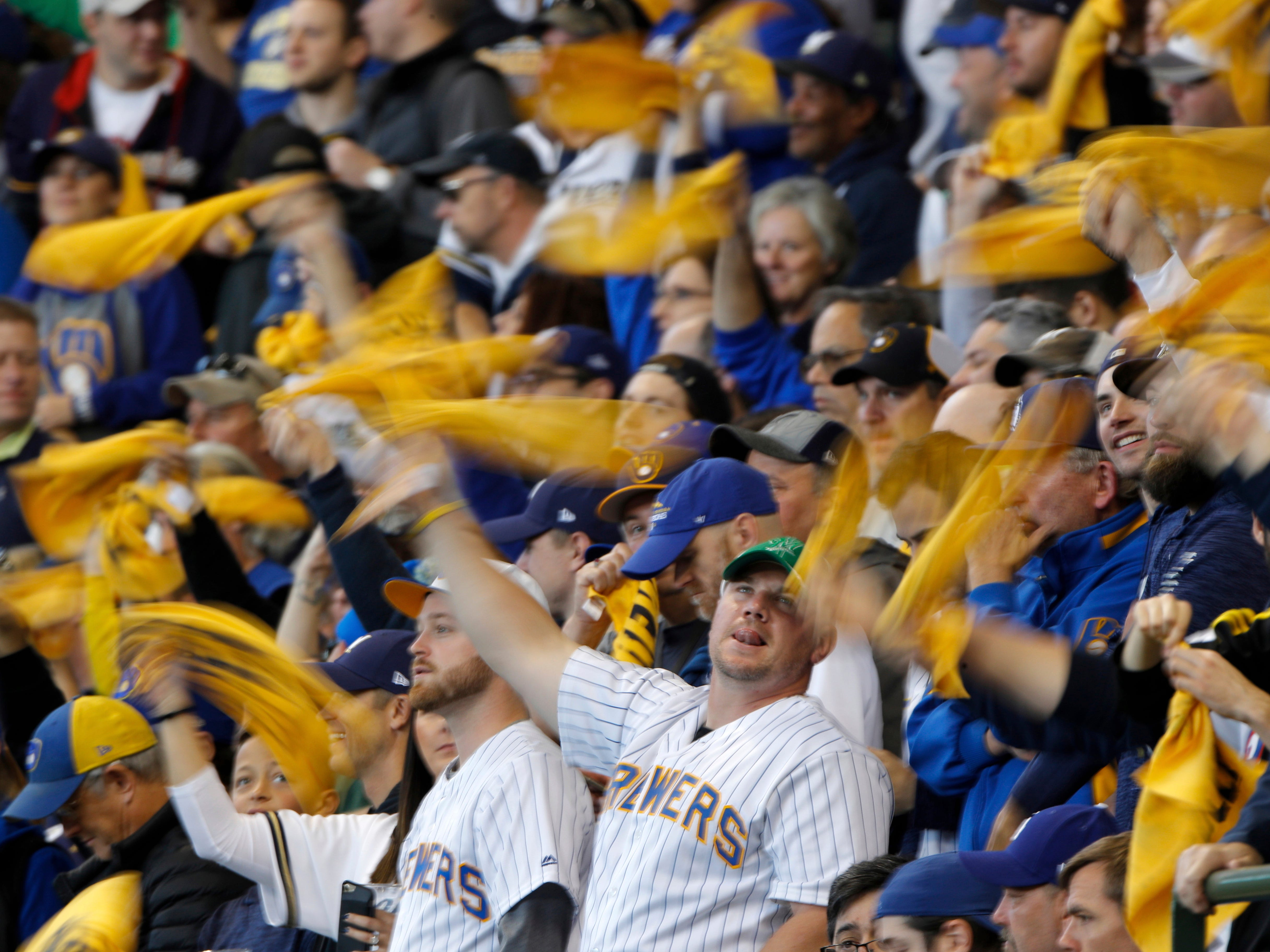 Fans cheer before Game 2 of the National League Championship Series baseball game between the Milwaukee Brewers and the Los Angeles Dodgers.