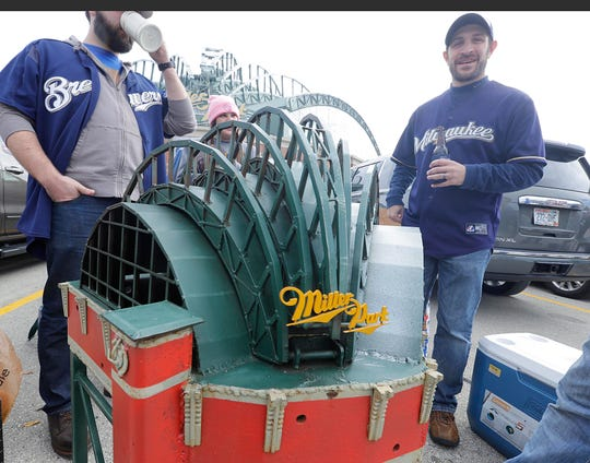 Dylan Brown (left), Brittany Brown, Josh Jenswold, Evan Olson, enjoy a brew with a  steel replica of Miller Park made 3 years ago by their friend  Matt Tyler who used to live in Brown Deer and tinkered in metal work.