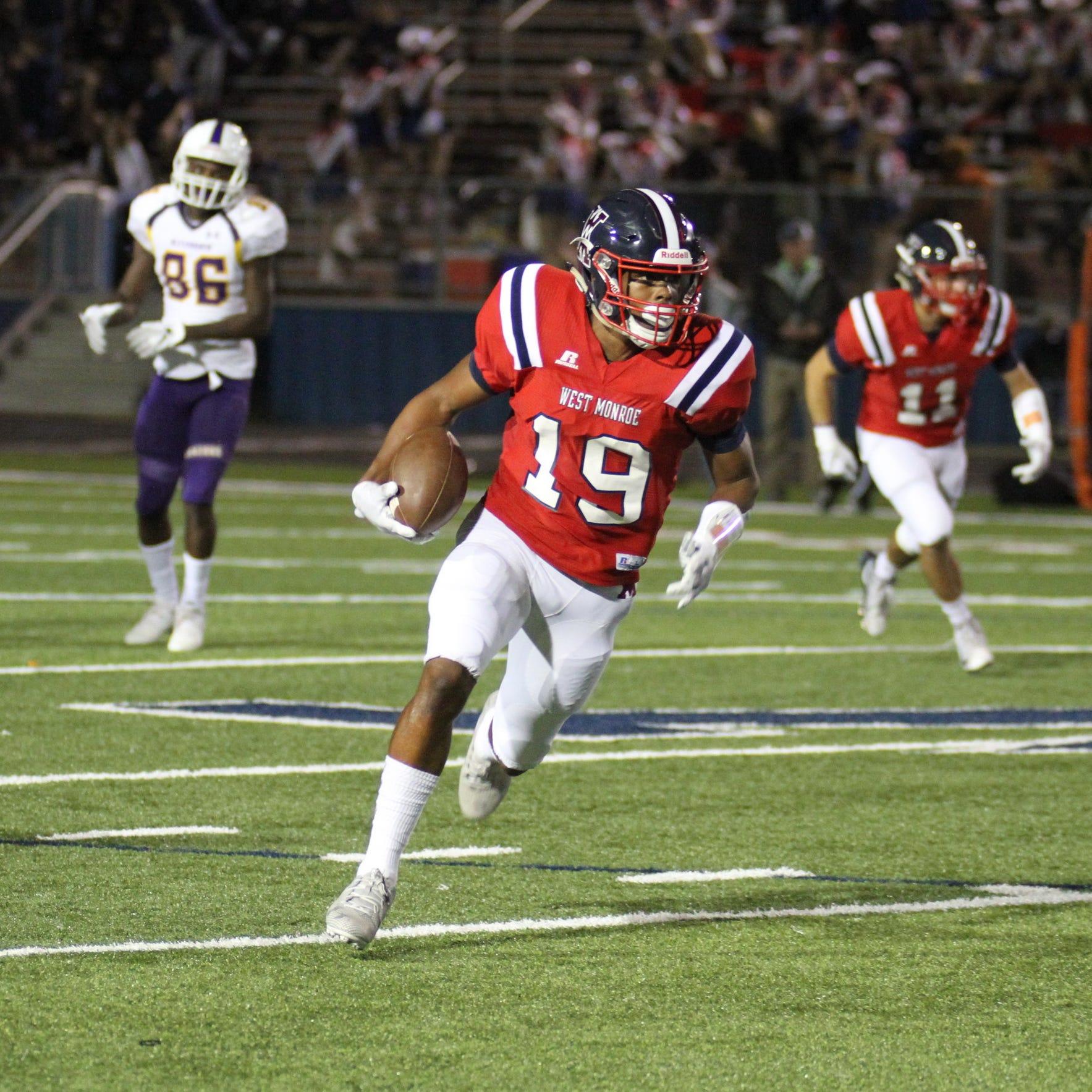 West Monroe senior cornerback Nobie Harris (19) returns an interception back for a touchdown against Alexandria Friday night at Rebel Stadium.