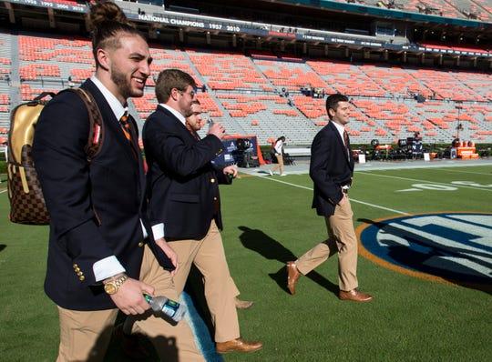 Auburn's Jarrett Stidham (8) jokes with teammates as they take the field following the Tiger Walk at Jordan-Hare Stadium in Auburn, Ala., on Saturday, Oct. 13, 2018.