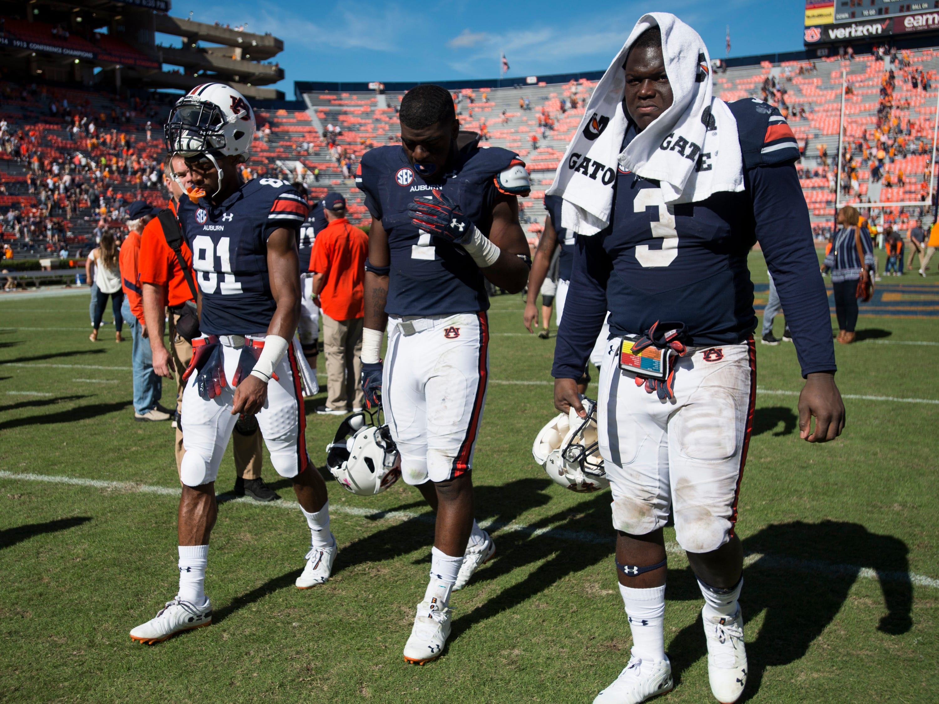 Auburn's Darius Slayton (81), Big Kat Bryant (1) and Marlon Davidson (3) walk off the field after the game at Jordan-Hare Stadium in Auburn, Ala., on Saturday, Oct. 13, 2018. Tennessee defeated Auburn 30-24.