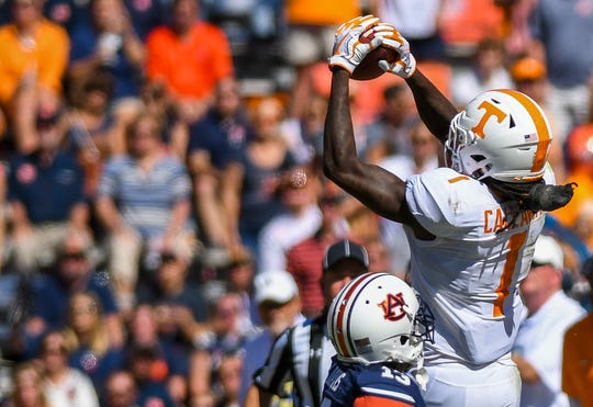 Tennessee wide receiver Marquez Callaway (1) completes a pass defended by Auburn defensive back Javaris Davis (13) during the second half Saturday, Oct. 13, 2018, at Jordan-Hare Stadium in Auburn, Ala.