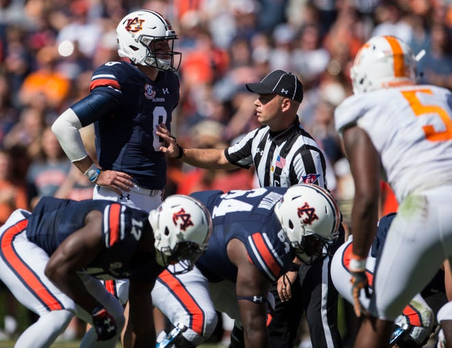 Auburn's Jarrett Stidham (8) is delayed by an official before snapping the ball against Tennessee at Jordan-Hare Stadium in Auburn, Ala., on Saturday, Oct. 13, 2018. Auburn leads Tennessee 17-13 at halftime.