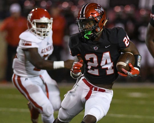Central-Phenix City's  A'montae Spivey runs the ball against Lee-Montgomery Friday, Oct. 12, 2018, in Phenix City, Ala.