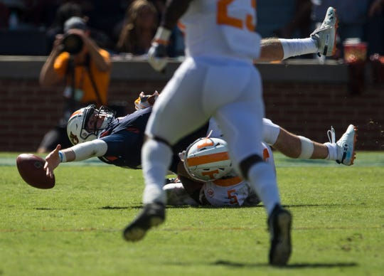 Auburn's Jarrett Stidham (8) reaches for a loose ball after being taken down by Tennessee's Kyle Phillips (5) at Jordan-Hare Stadium in Auburn, Ala., on Saturday, Oct. 13, 2018. Tennessee defeated Auburn 30-24.