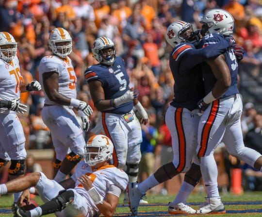 Auburn defensive lineman Marlon Davidson (3) celebrates teammate Nick Coe (91) sacking Tennessee quarterback Jarrett Guarantano (2) Saturday, Oct. 13, 2018, at Jordan-Hare Stadium in Auburn, Ala.