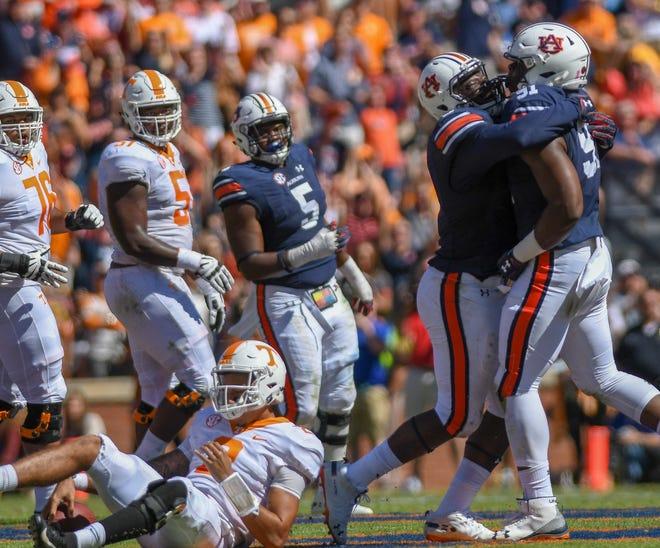 Auburn defensive lineman Marlon Davidson (3) celebrates teammate Nick Coe (91) sacking Tennessee quarterback Jarrett Guarantano (2) Saturday, Oct. 13, 2018, at Jordan-Hare Stadium in Auburn, Ala.