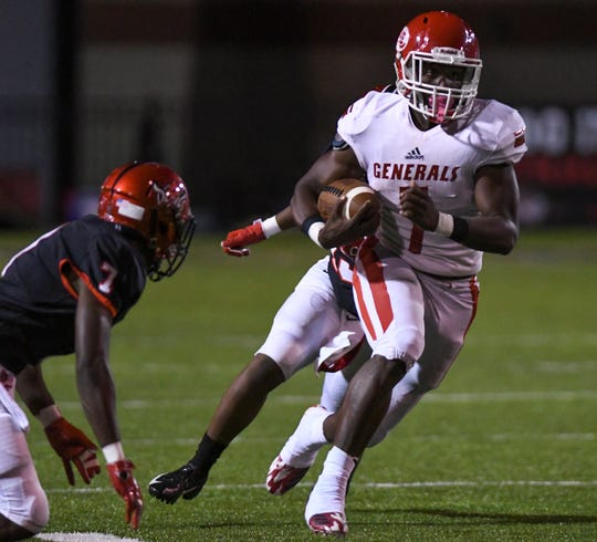 Lee-Montgomery's Tedarrian Murray runs the ball against Central-Phenix City Friday, Oct. 12, 2018, in Phenix City, Ala.