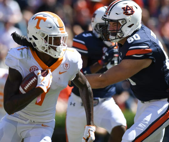 Tennessee wide receiver Marquez Callaway (1) runs the ball past Auburn long snapper Bill Taylor (60) during the second half Saturday, Oct. 13, 2018, at Jordan-Hare Stadium in Auburn, Ala.