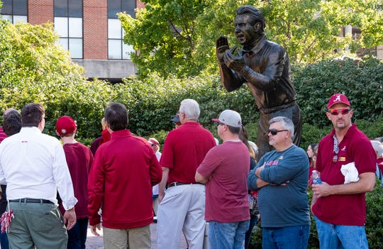 Fans line up to take photos with the statue of Nick Saban as they arrive for the Alabama vs. Missouri game at Bryant Denny Stadium in Tuscaloosa, Ala., on Saturday October 13, 2018.