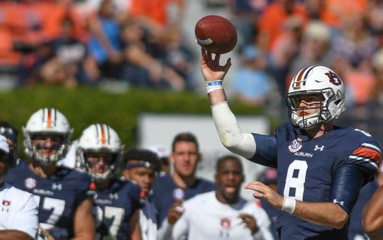 Auburn quarterback Jarrett Stidham (8) throws the ball away during the second half against Tennessee Saturday, Oct. 13, 2018, at Jordan-Hare Stadium in Auburn, Ala.