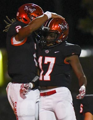 Central-Phenix City's Louis Hicks celebrates a touchdown against Lee-Montgomery Friday, Oct. 12, 2018, in Phenix City, Ala.