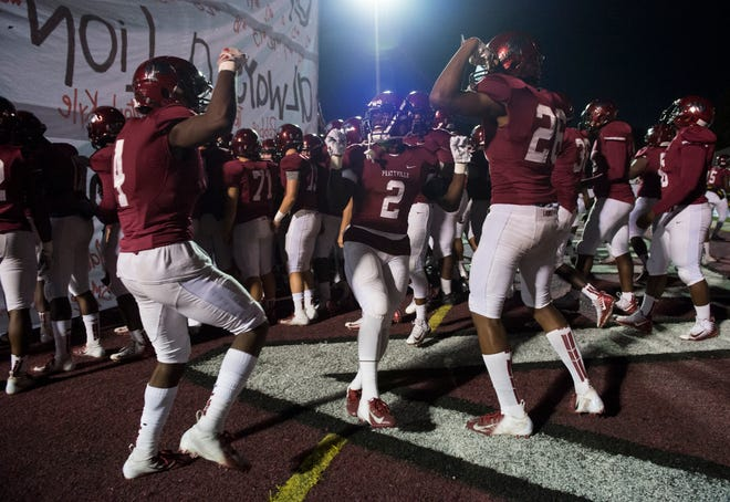 Prattville players dance before being introduced at Stanley- Jensen Stadium in Montgomery, Ala., on Friday, Oct. 12, 2018. Jeff Davis leads Prattville 19-13 at halftime.