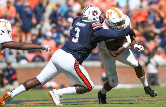 Auburn defensive lineman Marlon Davidson (3) stops Tennessee running back Ty Chandler (8) during the second half Saturday, Oct. 13, 2018, at Jordan-Hare Stadium in Auburn, Ala.