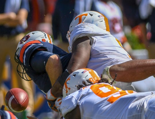 Tennessee defensive linemen Alexis Johnson Jr. (98) and Kyle Phillips (5) hit Auburn quarterback Jarrett Stidham (8) and cause a fumble during the second half Saturday, Oct. 13, 2018, at Jordan-Hare Stadium in Auburn, Ala.