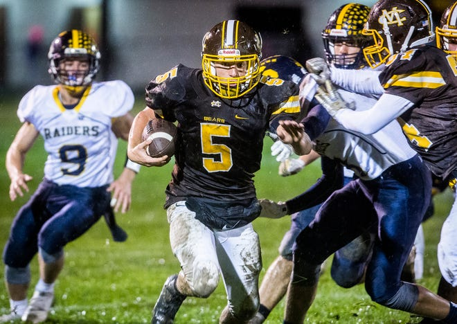 Monroe Central's Seth Wilson runs the ball against Shenandoah's defense during their game at Monroe Central High School Friday, Oct. 12, 2018.
