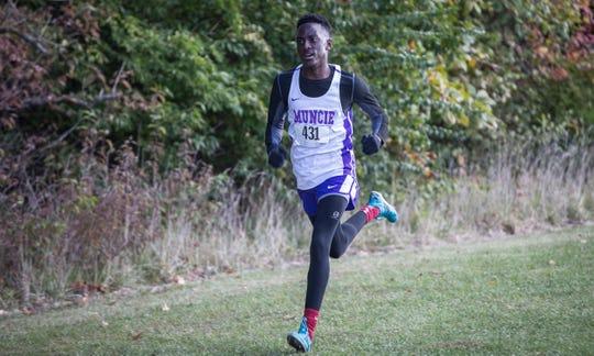 FILE -- Muncie Central's Isaiah Strong runs during a previous cross country regional at the Muncie Sportsplex.