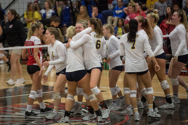 Delta celebrates a win against Wapahani during the semi-final on Oct. 13 at Wapahani High school.