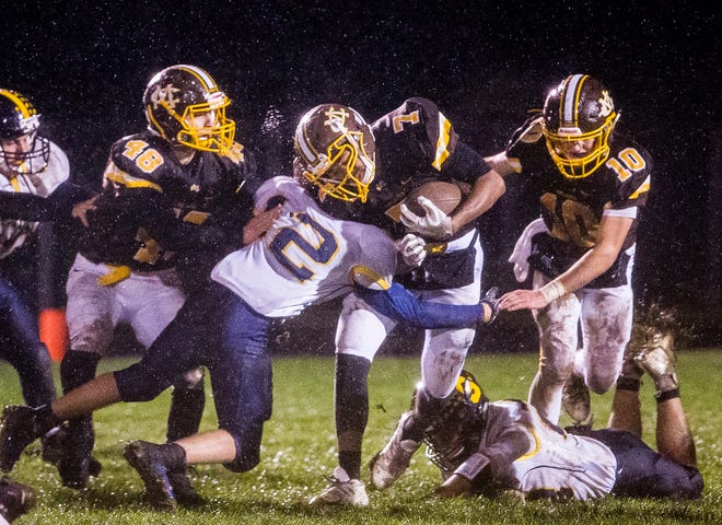 Monroe Central's Malcolm Armour struggles past Shenandoah's defense during their game at Monroe Central High School Friday, Oct. 12, 2018.