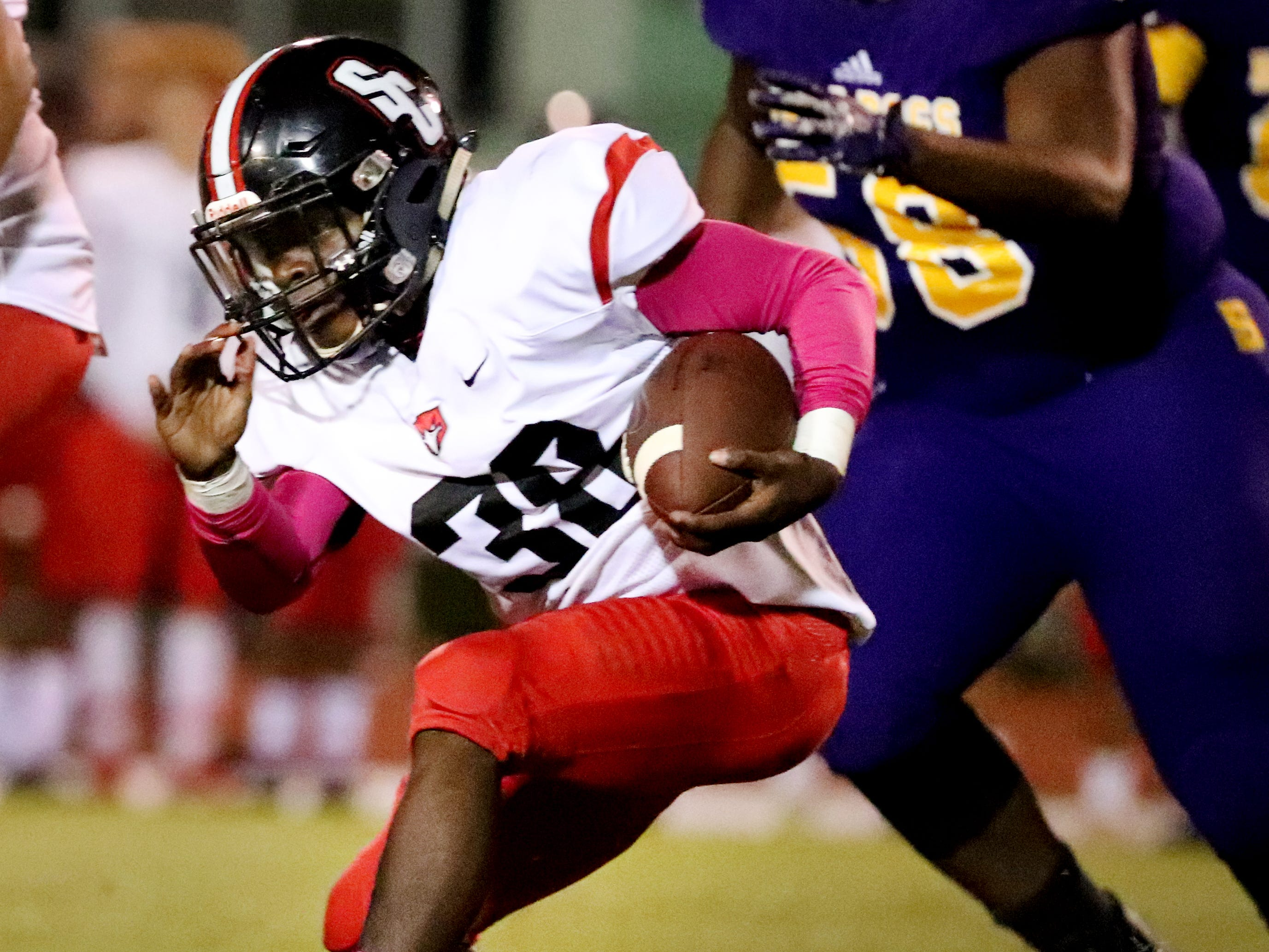 Stewarts Creek's Amari Jelks (38) runs the ball against Smyrna at Smyrna High School on Friday, Oct. 12, 2018.