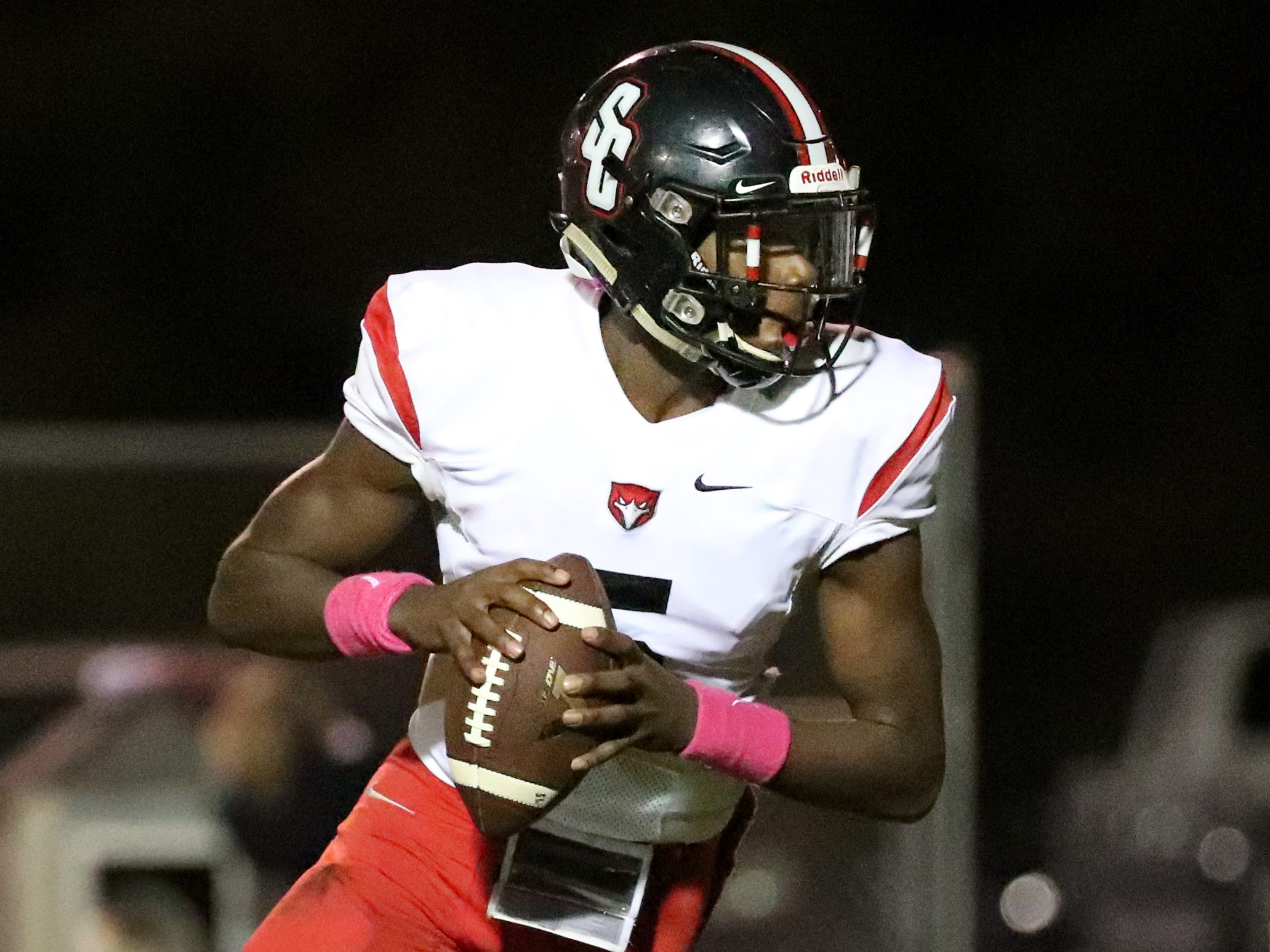 Stewarts Creek's quarterback Jonnie Simmons (5) looks for a player to pass to during the game against Smyrna at Smyrna High School on Friday, Oct. 12, 2018.