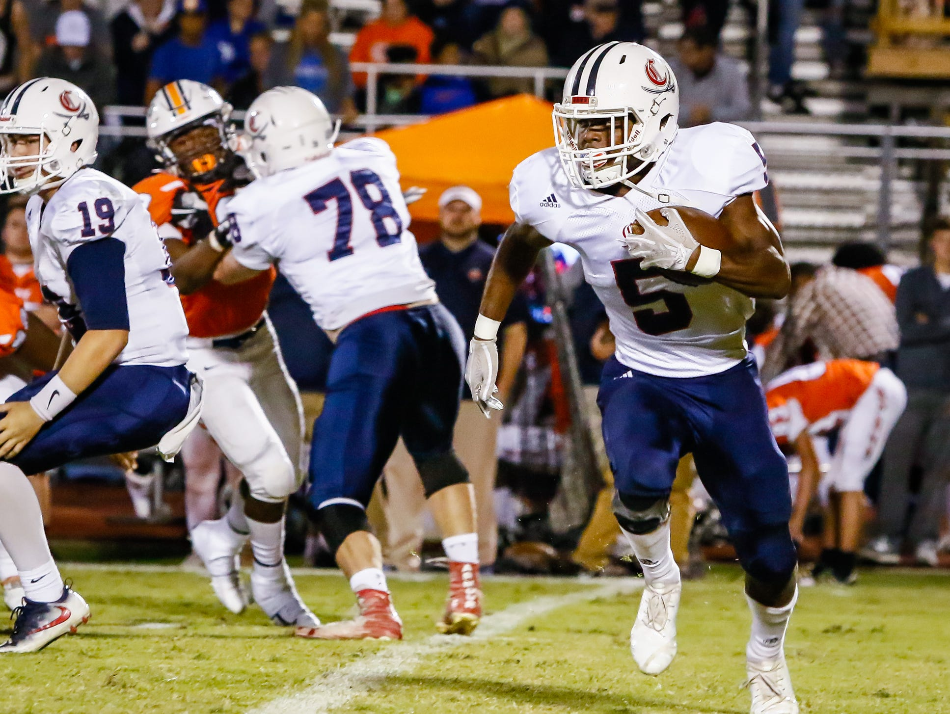 Cookeville running back Jaden McAlister finds running room in Blackman's defense.