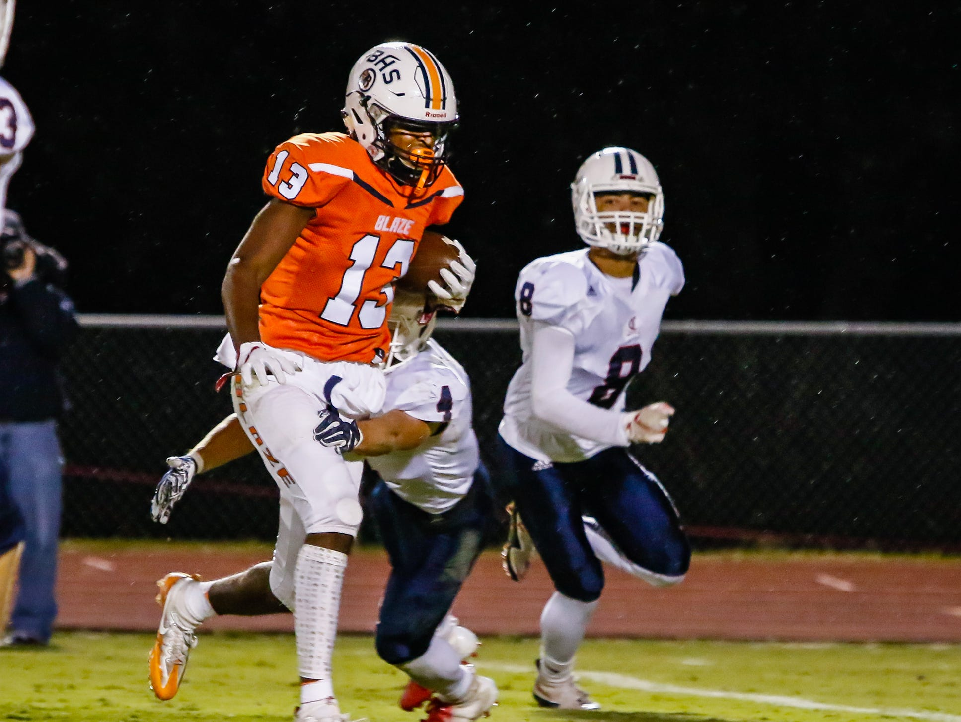 Blackman's Trey Knox runs through Cookeville defenders.
