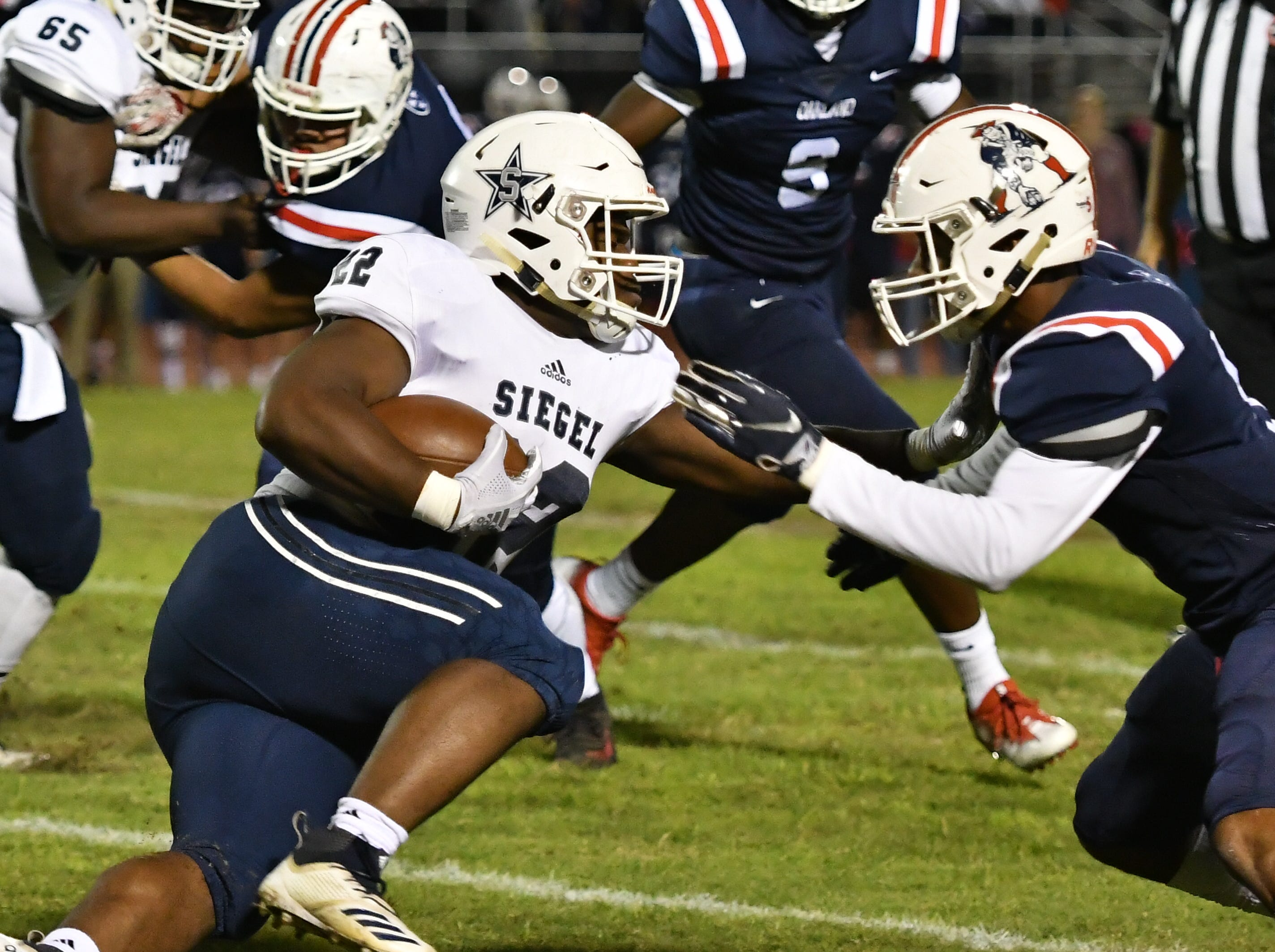 Siegel running back Pat Boykins carries the ball against Oakland Friday night.