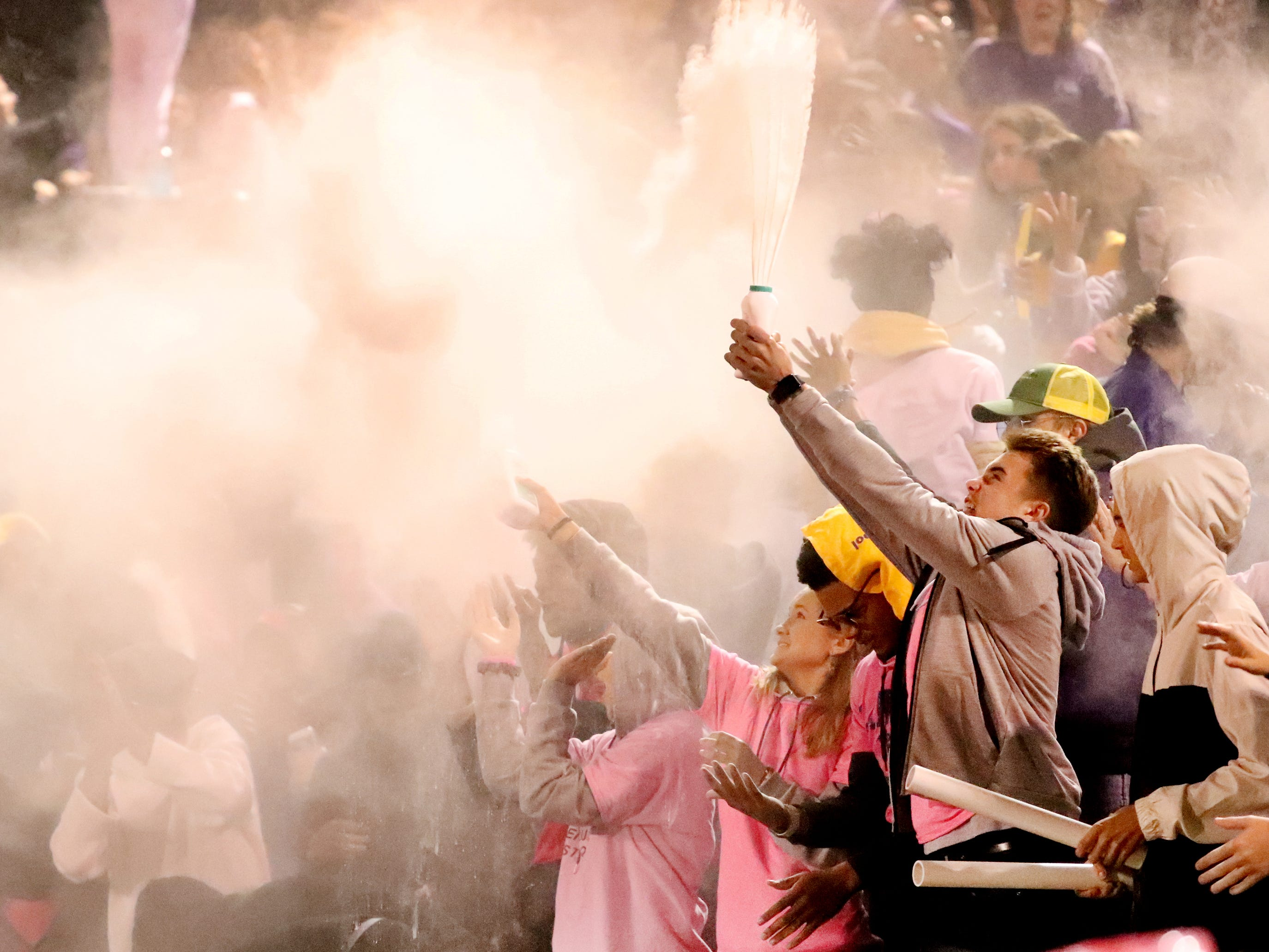 Smyrna fans toss baby powder in the air between the 3rd and 4th quarter during the game against Stewarts Creek at Smyrna High School on Friday, Oct. 12, 2018.