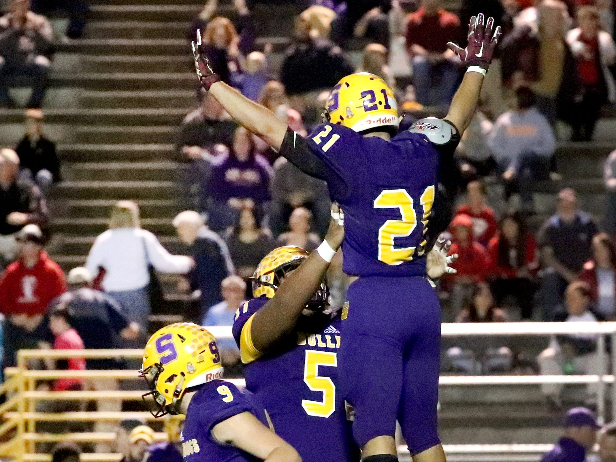 Smyrna's Blake Watkins (21) and Marlon Alexander (51) celebrate a touchdown made by Watkins against Stewarts Creek at Smyrna High School on Friday, Oct. 12, 2018.