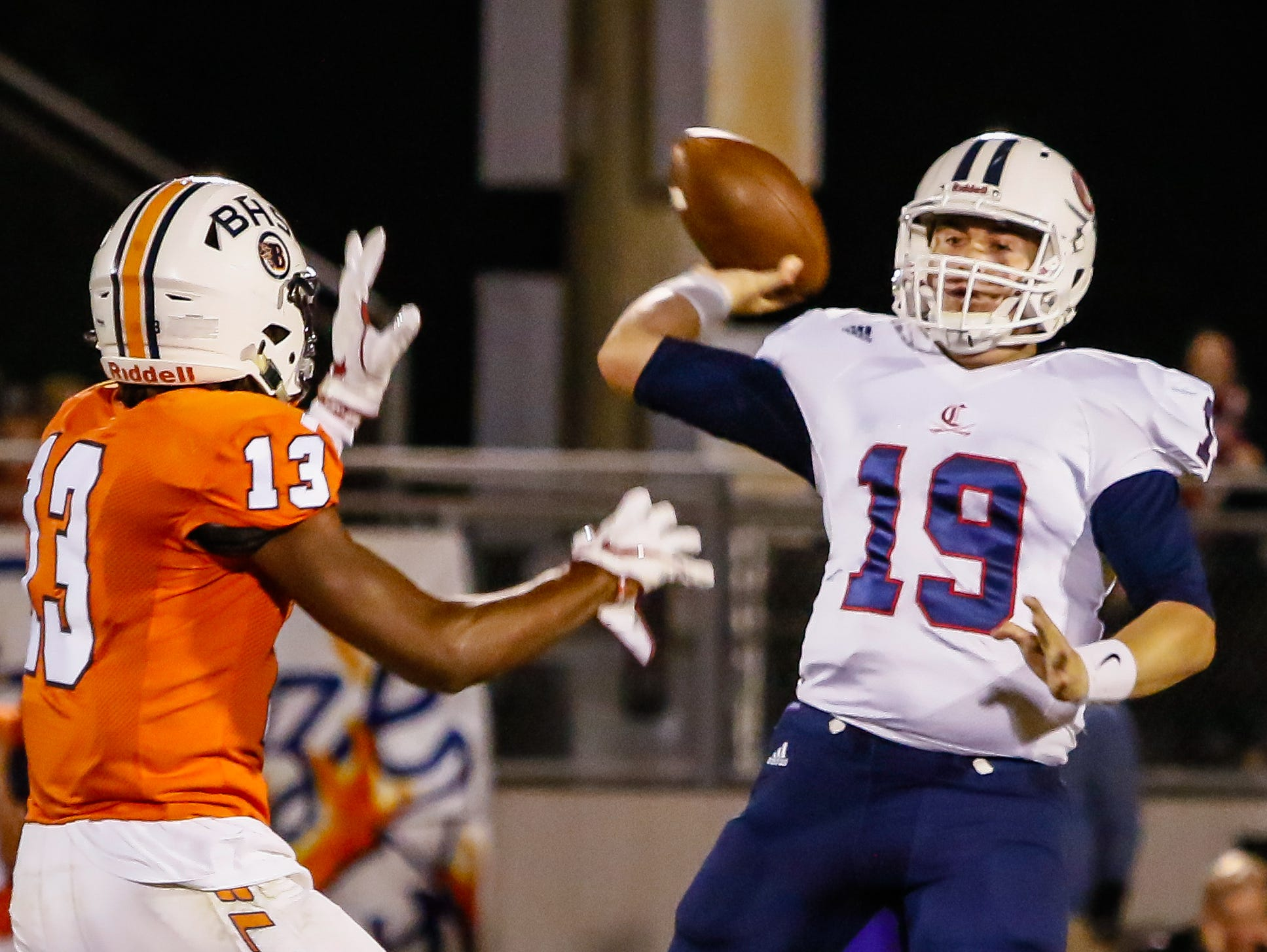 Blackman's Trey Knox puts pressure on Cookeville quarterback Robert Espinosa.
