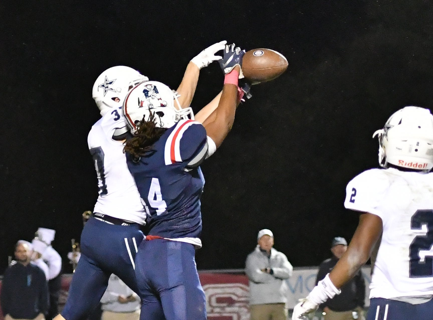 Oakland's Mikhael Holman goes up for a pass Friday night against Siegel.