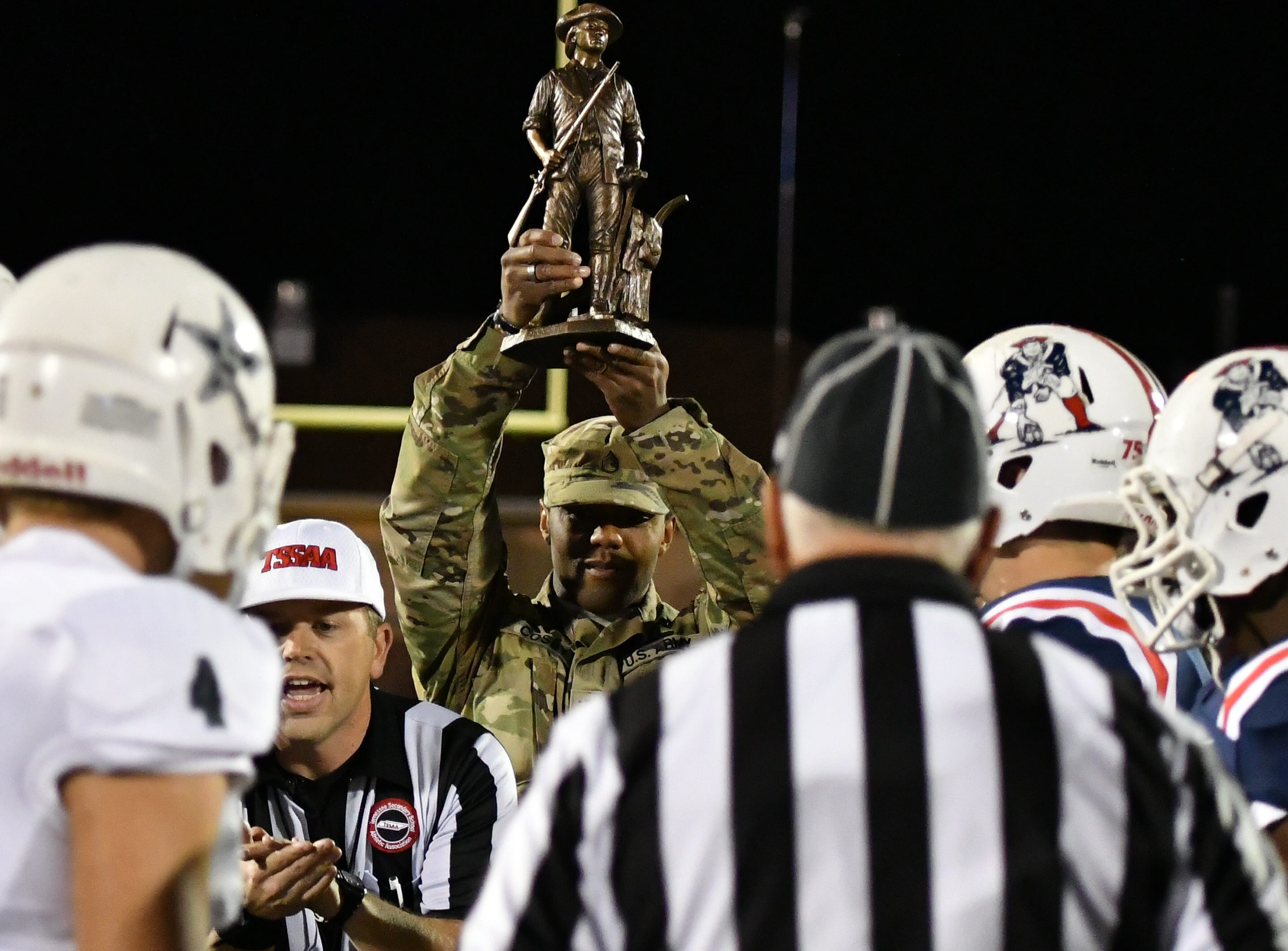 The Tennessee Army National Guard oversees the coin toss Friday night as Oakland hosted Siegel.