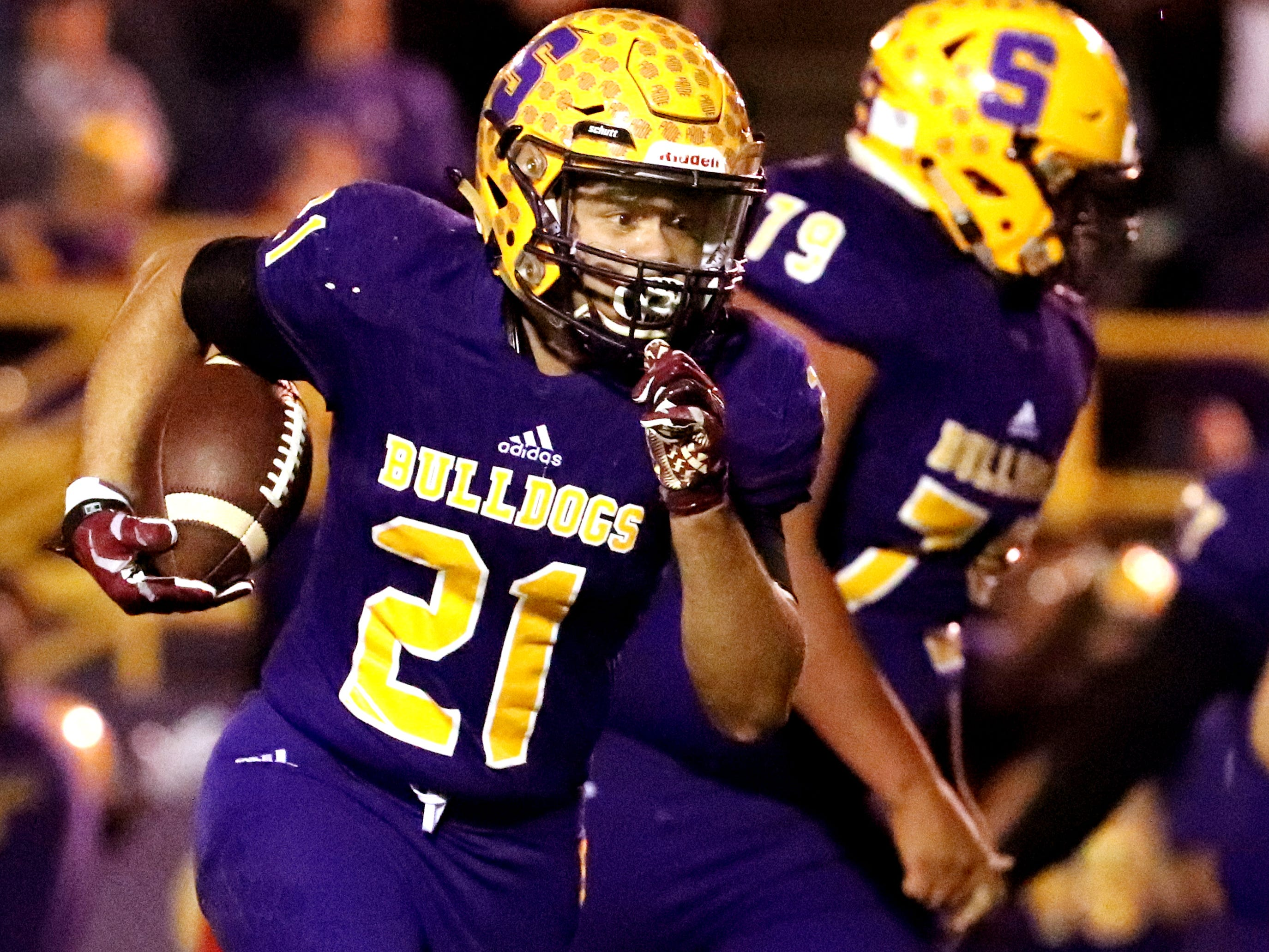 Smyrna's Blake Watkins (21) runs the football in for a touchdown during the game against Stewarts Creek at Smyrna High School on Friday, Oct. 12, 2018.