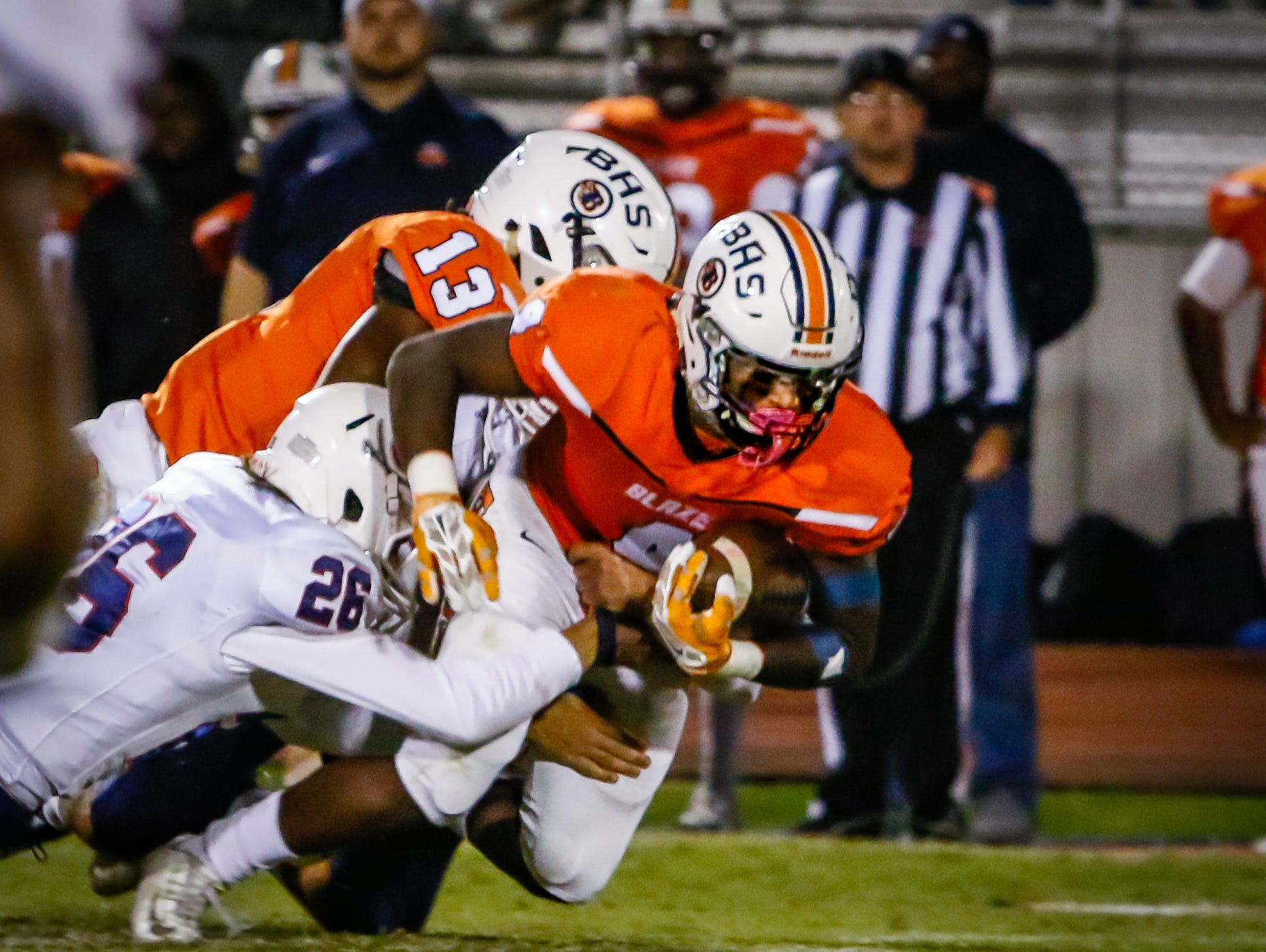 Jordan Brown carries the ball for Blackman during Friday's game against Cookeville.