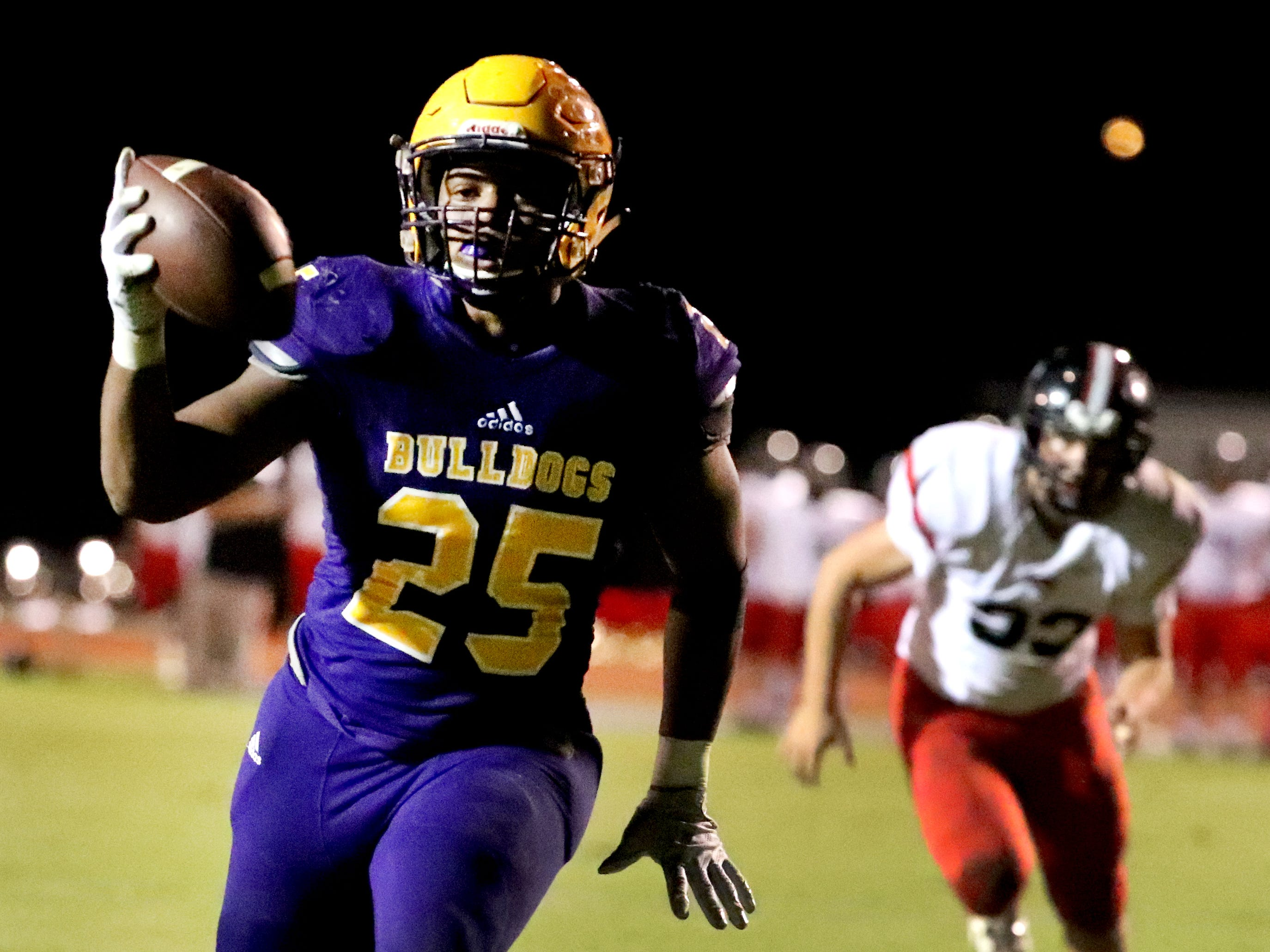Smyrna's Josh Bailey (25) runs the ball in for a touchdown against Stewarts Creek at Smyrna High School on Friday, Oct. 12, 2018.