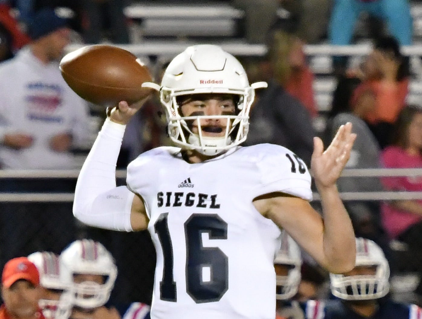 Siegel QB Tucker Sears throws a pass against Oakland Friday night.