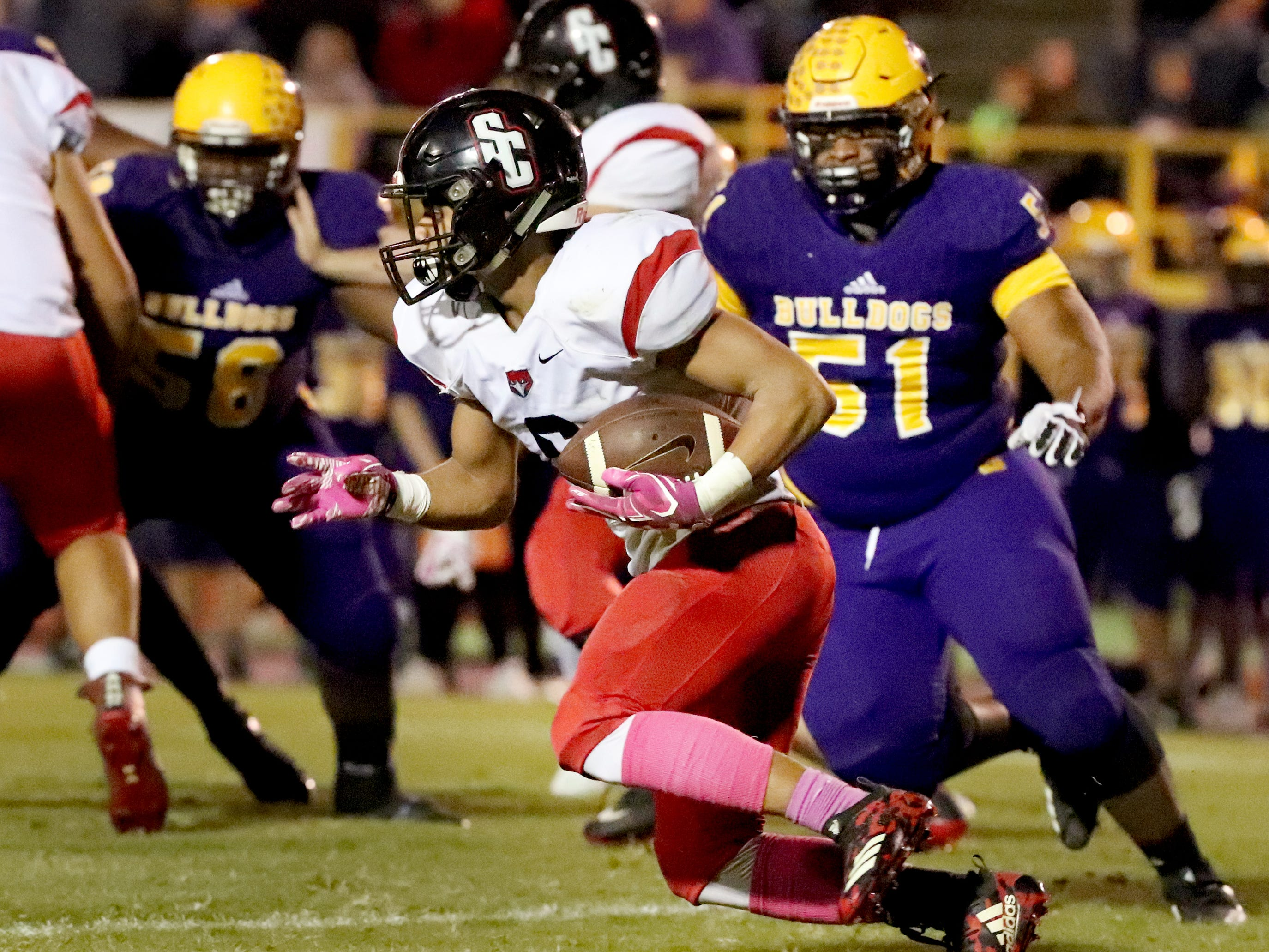 Stewarts Creek's Savion Davis (6) runs the ball as Smyrna's Marlon Alexander (51) moves in for a tackle at Smyrna High School on Friday, Oct. 12, 2018.