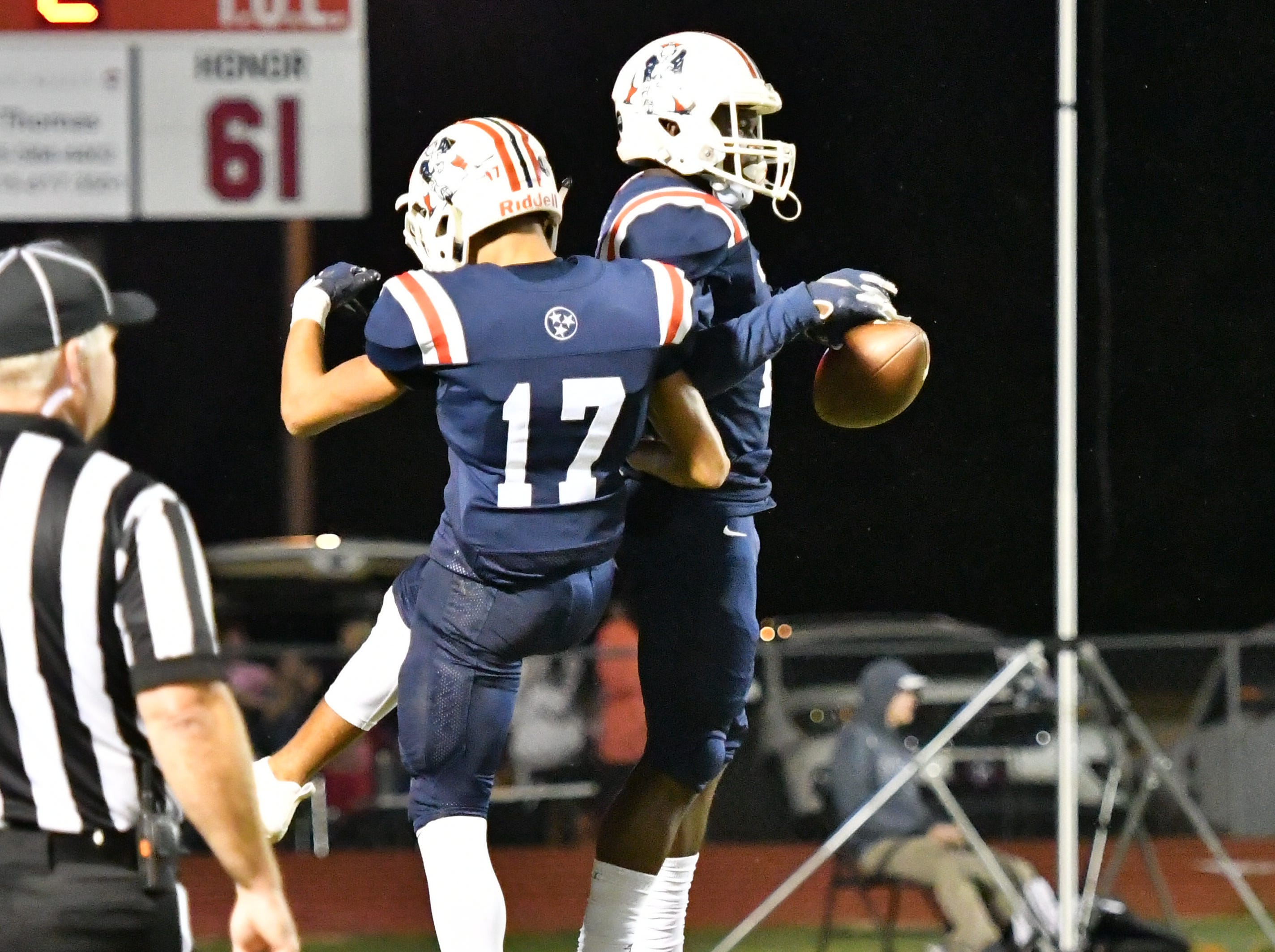Oakland's Kameron Goodrich celebrates his touchdown with teammate Eddie Willis against Siegel Friday night.