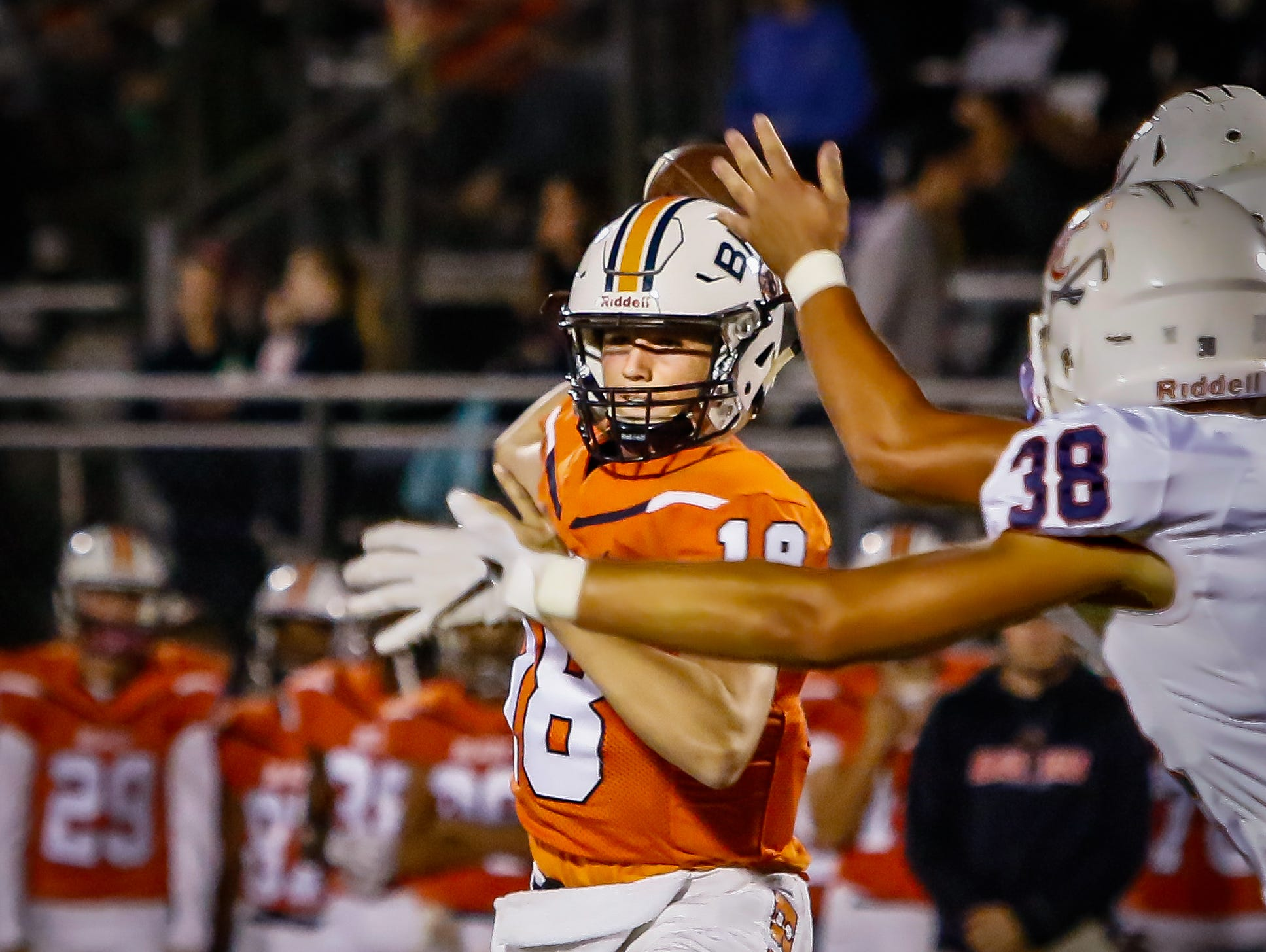 Blackman quarterback Drew Beam finds a receiver while being pressured from Cookeville defenders.