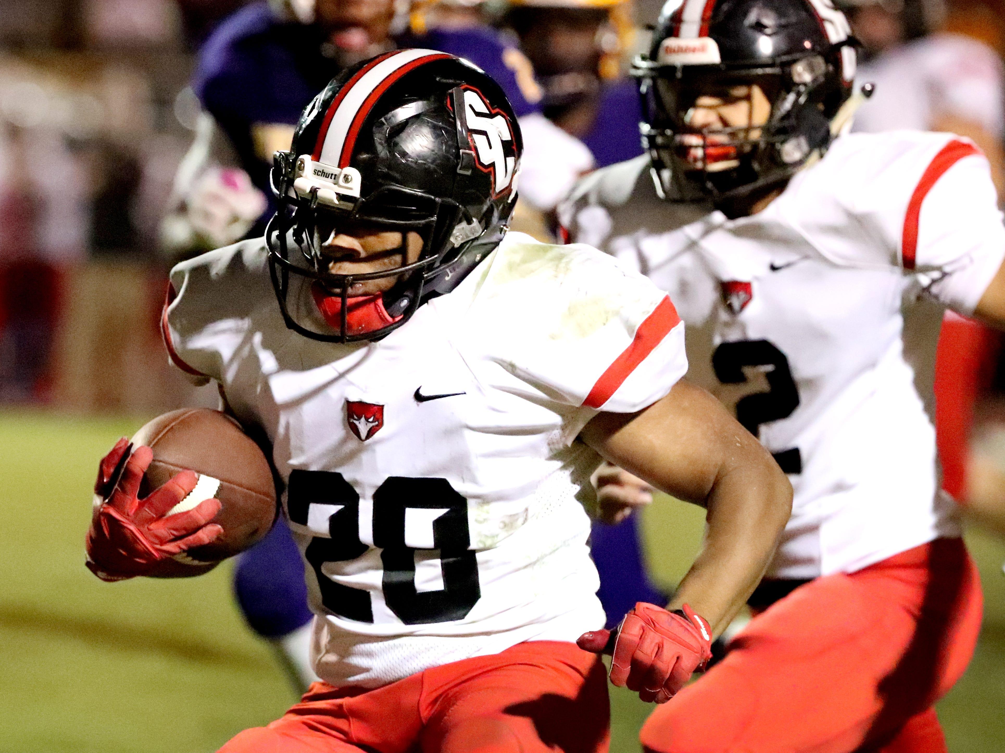 Stewarts Creek's Nathan Wright (28) runs the ball against Smyrna at Smyrna High School on Friday, Oct. 12, 2018.