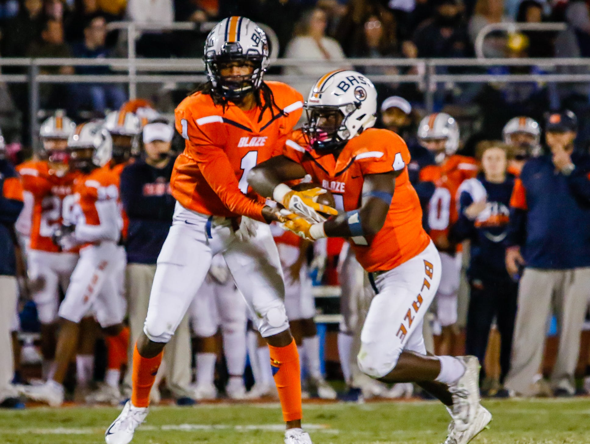 Blackman's Adonis Otey hands off to Jordan Brown in Blackman's win over Cookeville.