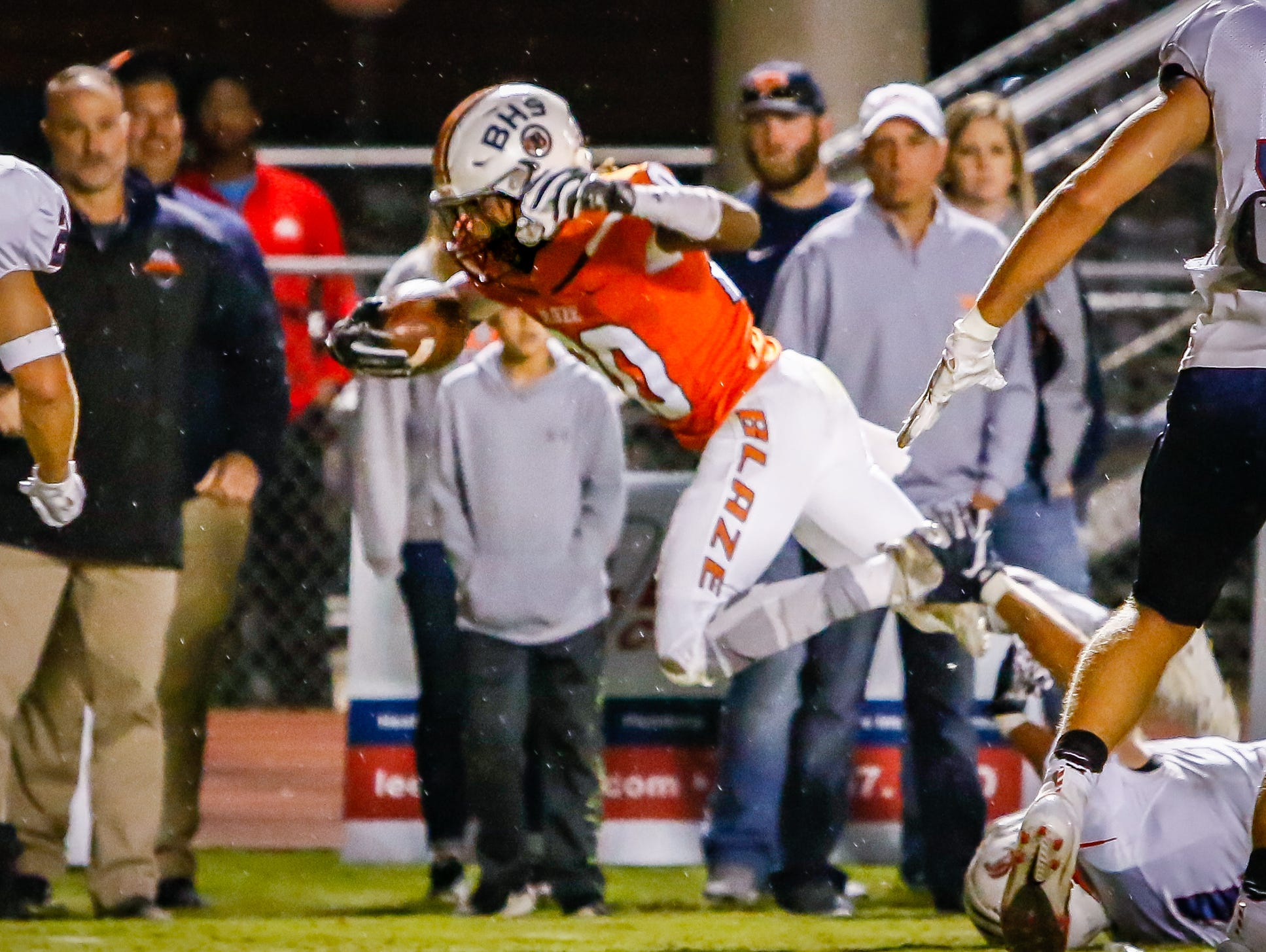 Michaleous Elder escapes a tackle to find the end zone for a Blackman touchdown.