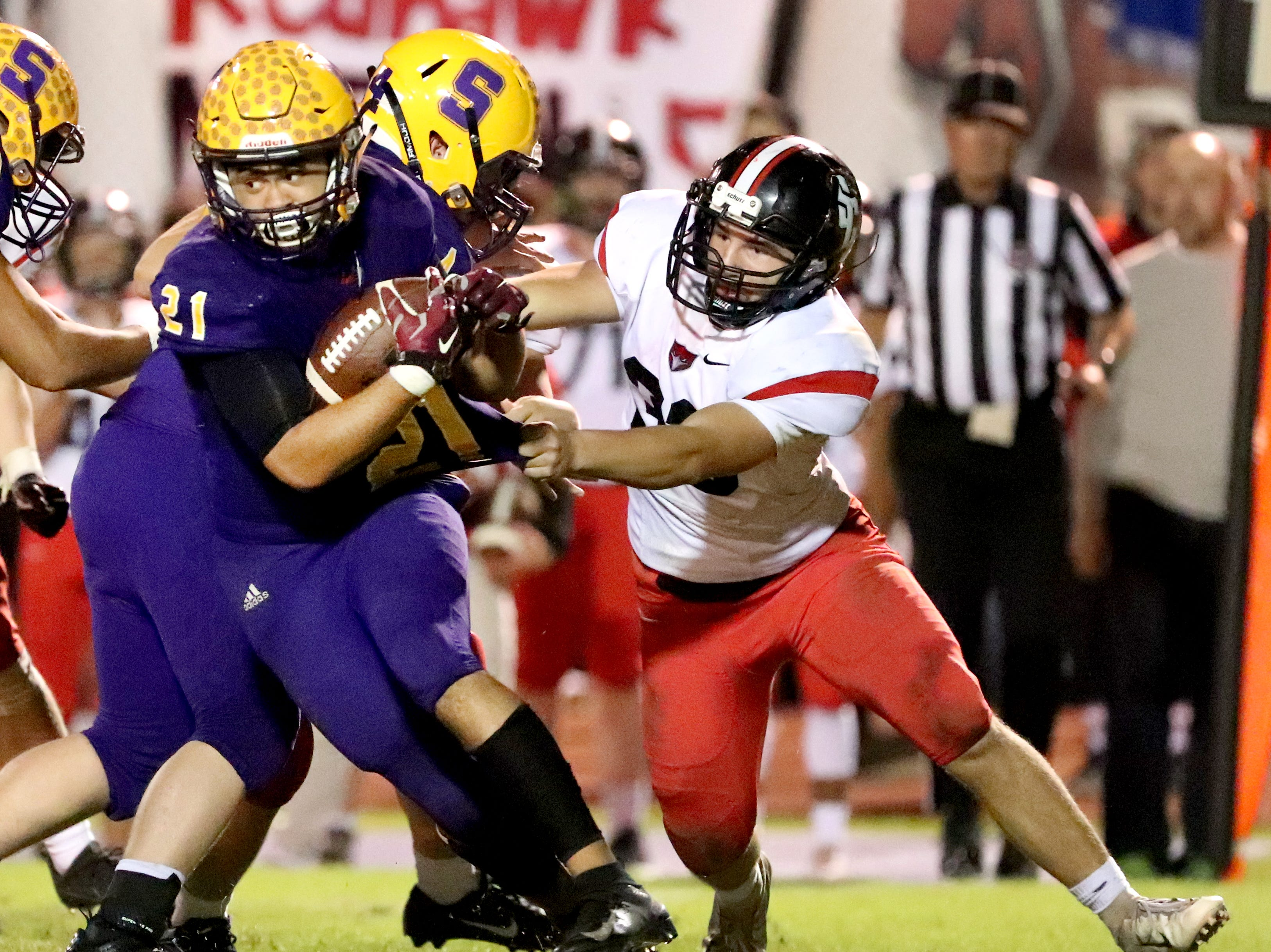 Smyrna's Blake Watkins (21) runs the football as Stewarts Creek's Bryce Haven (33) tried to make a stop at Smyrna High School on Friday, Oct. 12, 2018.