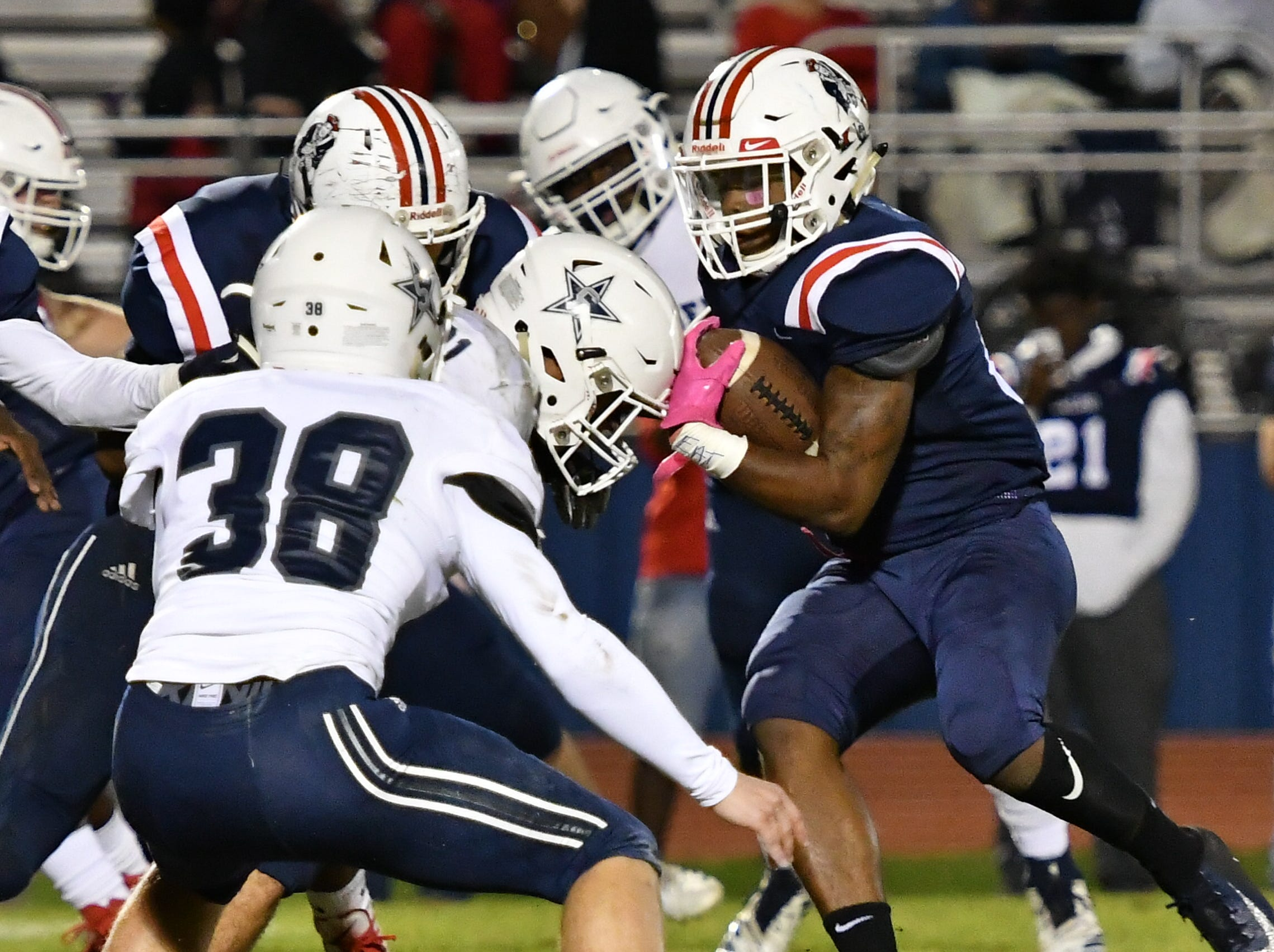 Oakland running back Xavier Myers carries for a short gain against Siegel Friday night.