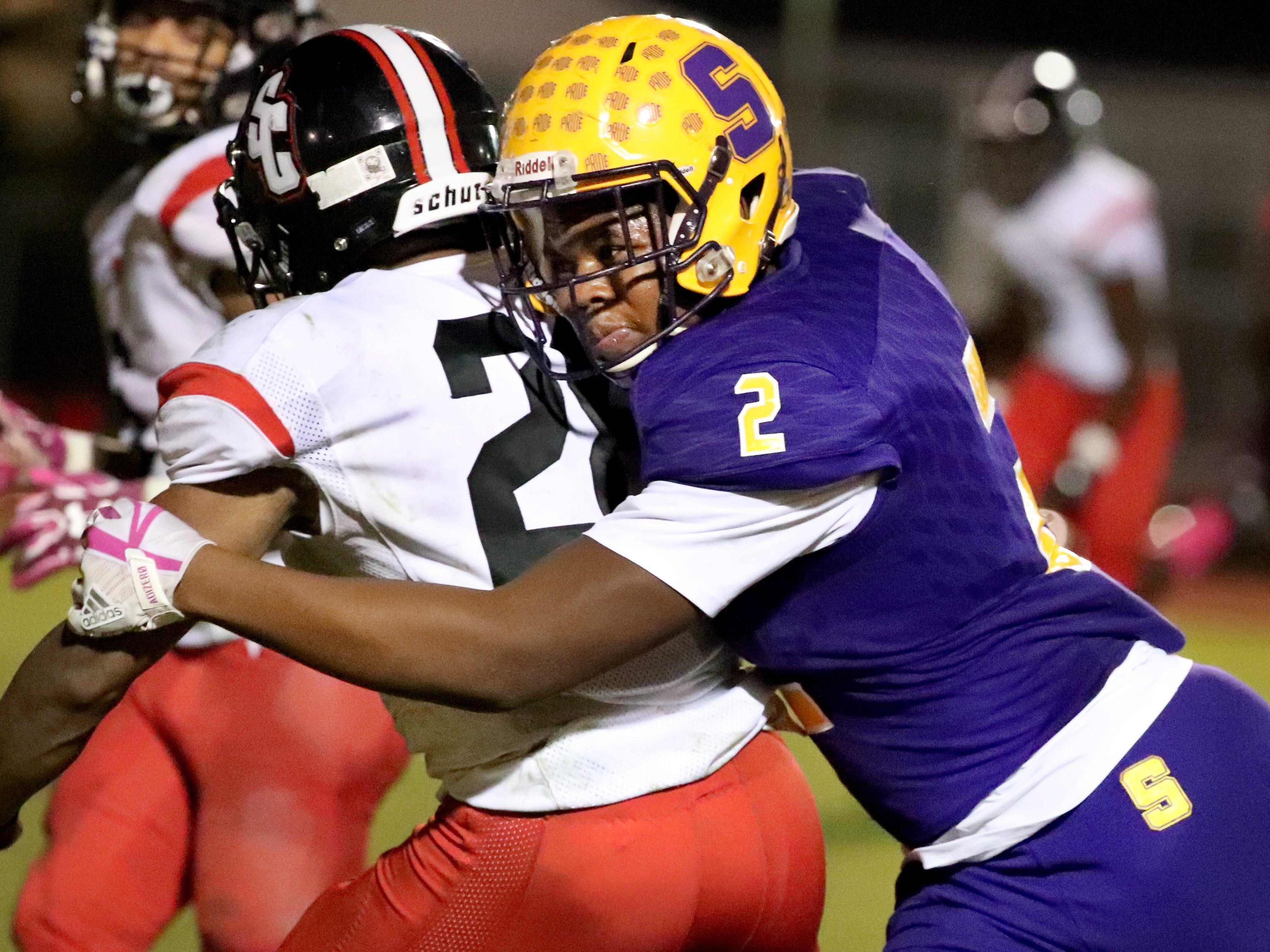 Smyrna's Kobe Okeke (2) tackles and stops Stewarts Creek's Nathan Wright (28) at Smyrna High School on Friday, Oct. 12, 2018.