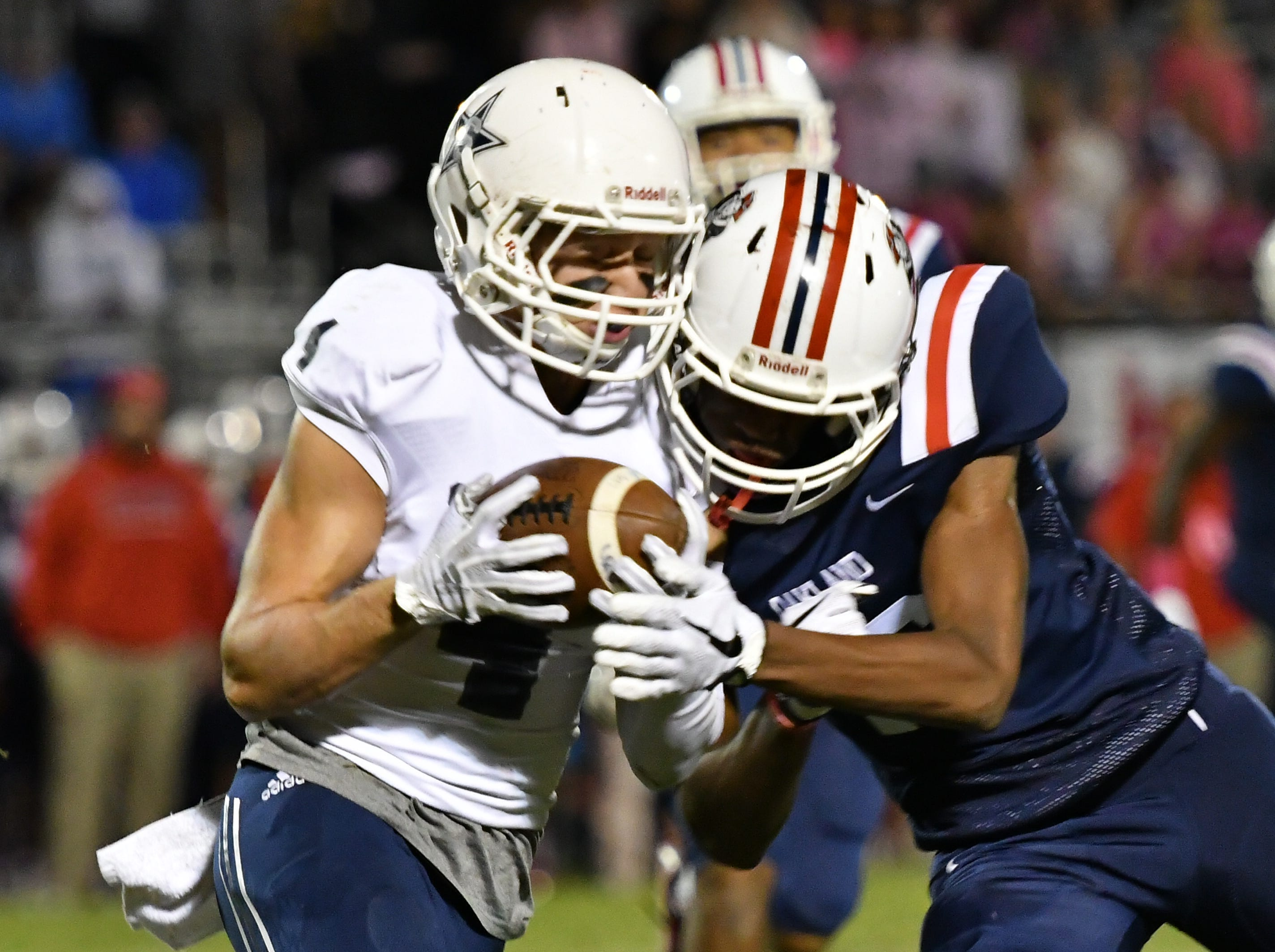 Siegel's Evan Milligan picks up an Oakland fumble and carries the ball downfield Friday night.