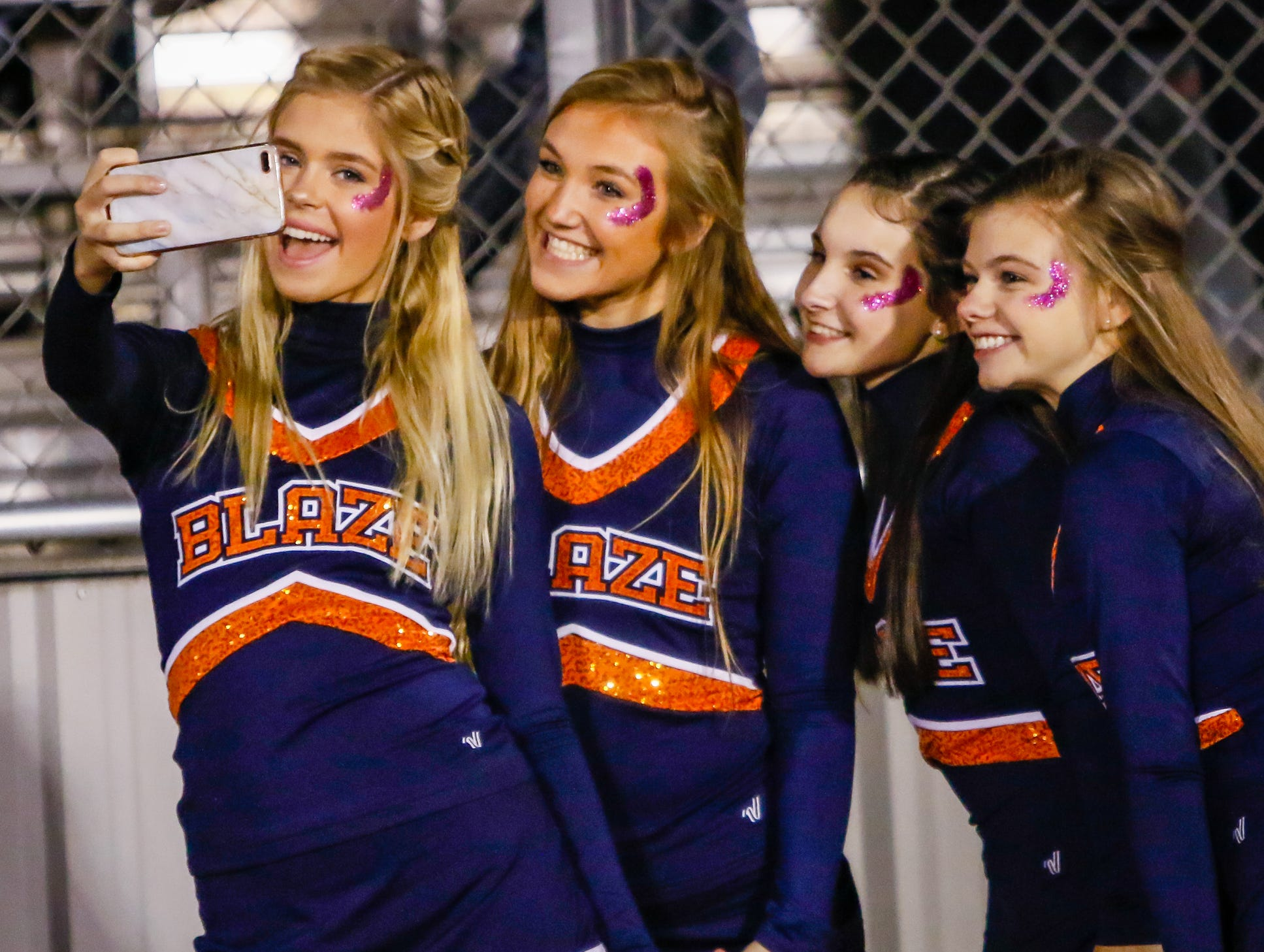 Blackman cheerleaders take time for a selfie prior to kickoff.