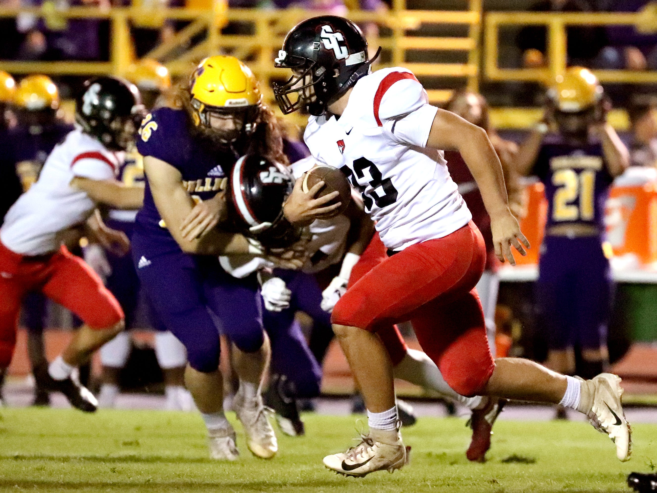 Stewarts Creek's Bryce Haven (33) runs the ball against Smyrna at Smyrna High School on Friday, Oct. 12, 2018.